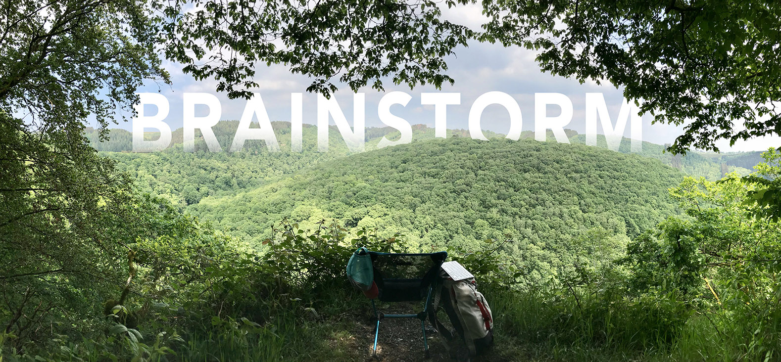 A hilly and foresty landscape into which the word BRAINSTORM is embedded